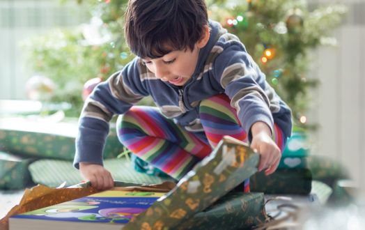 Charity-Gifts-Boy-Unwrapping-Christmas-Gift